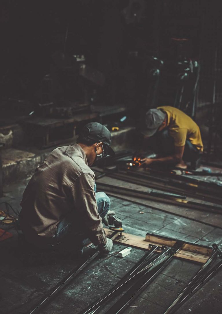 foreign labour working on welding